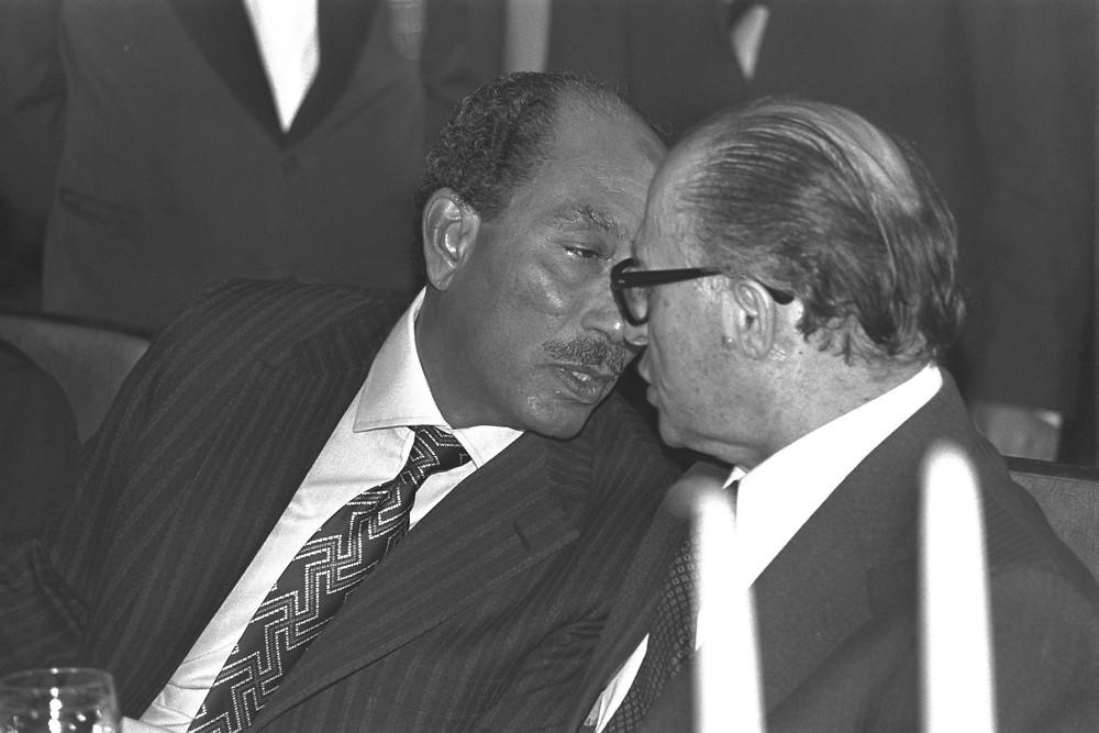Anwar Sadat wearing a swastika tie while talking with Menachem Begin (Image credit: Ya'acov Sa'ar/Government Press Office of Israel)