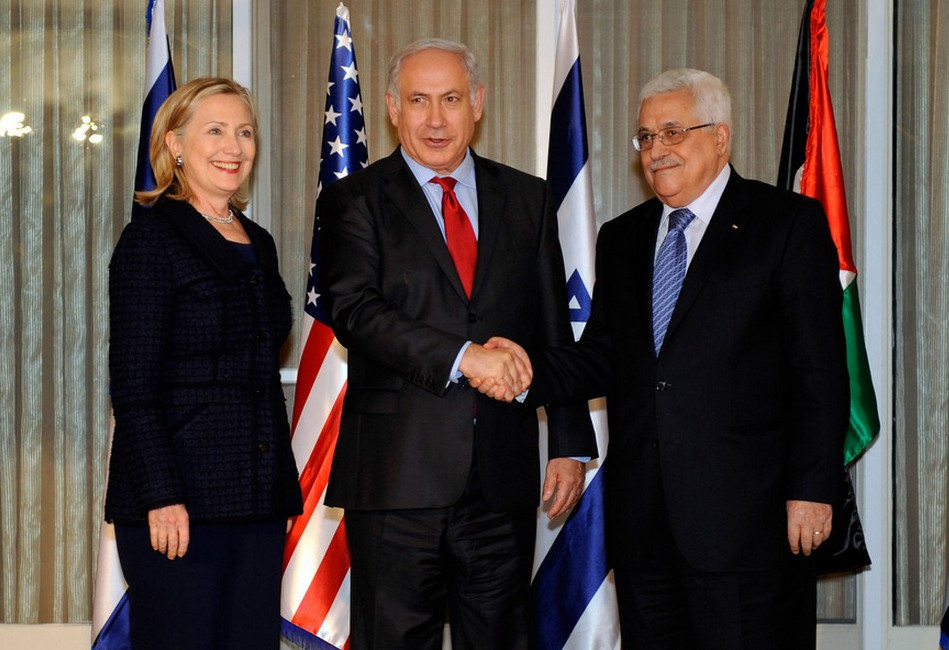 Illustration: Netanyahu and Abbas Shake Hands as Secretary Clinton Looks On by US Department of State via flickr [Public Domain]