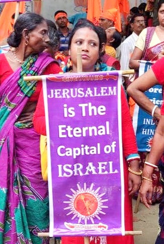 Woman Holds Jerusalem Sign (Image Credit: Courtesy Singha Bahini)