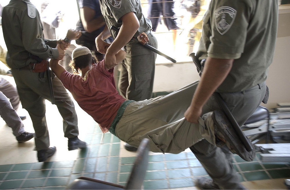 llustration: Security Forces Arrest Young Man by Israel Defense Forces [CC BY-SA 2.0], via Flickr
