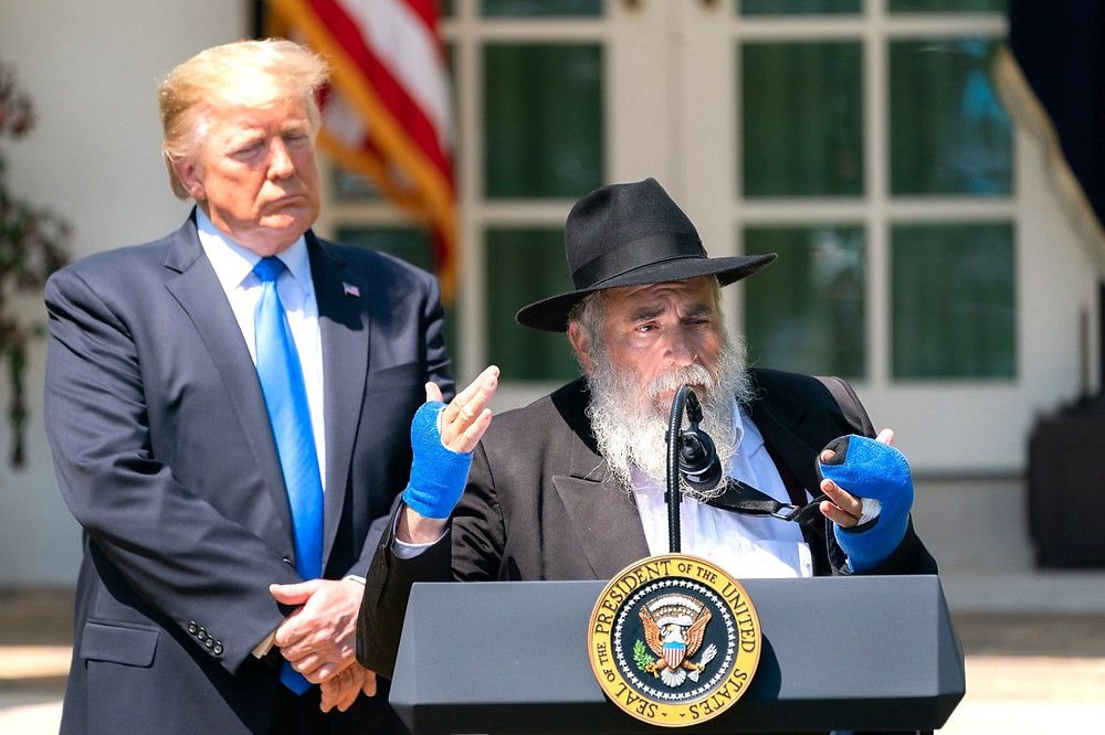 President Donald J. Trump listens to Rabbi Yisroel Goldstein of the Chabad of Poway, Calif. (Official White House Photo by Tia Dufour [Public Domain])
