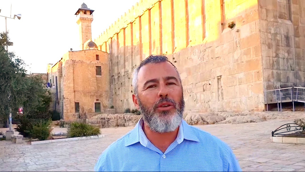 Illustration: Yishai Fleischer at Cave of Machpelah, Hebron, Screenshot (Boomerang's YouTube Weekly Terror Report 02:24)