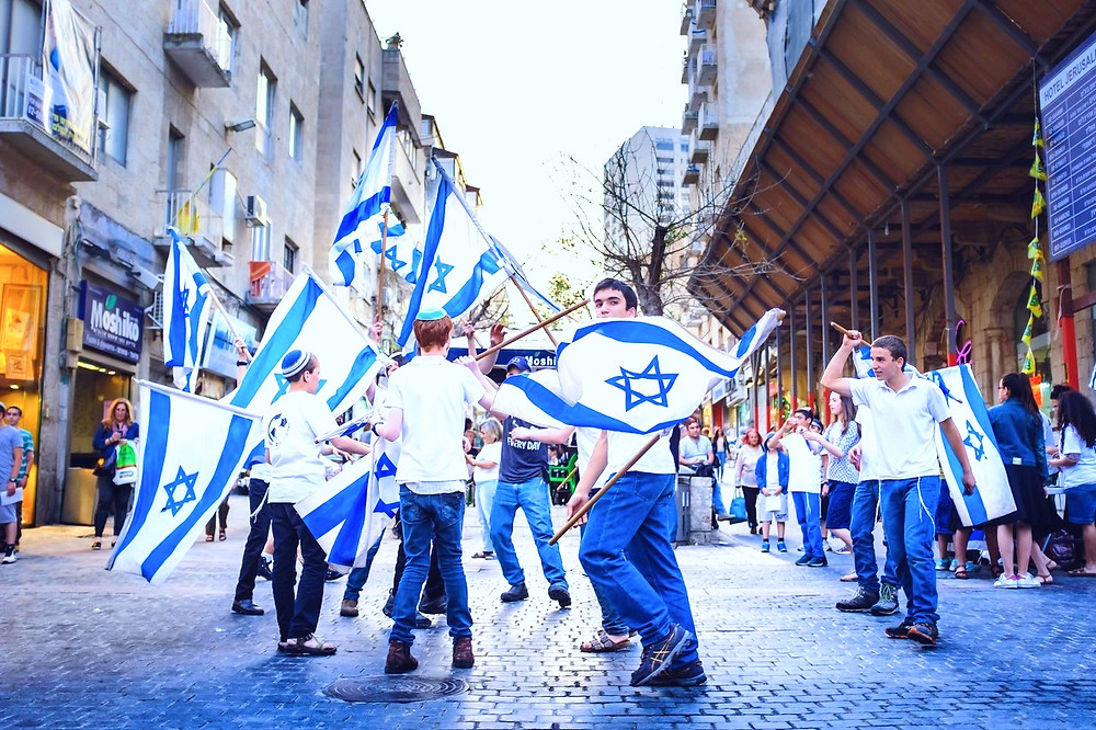 Israeli Kids with Flags in Jerusalem by Kristoffer Trolle [CC BY 2.0] via Flickr