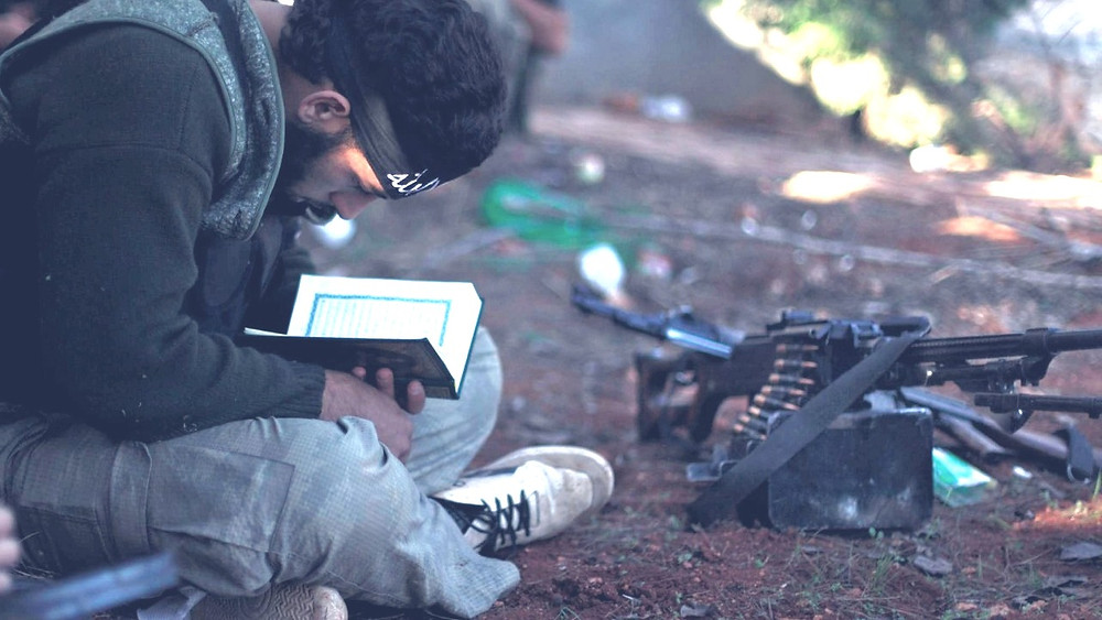 Illustration: Syrian ISIS Fighter Reads Quran by William Proby [Public Domain] via Flickr