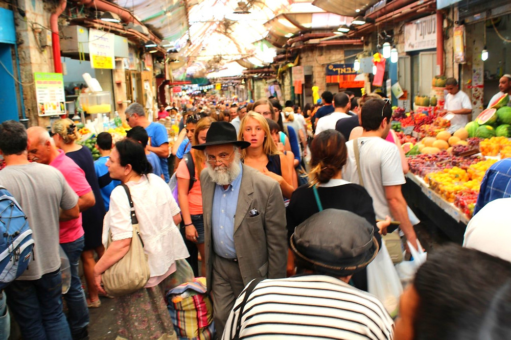 Shopping at Machane Yehuda Market by Avi Deror [CC BY-SA 3.0] via Wikimedia