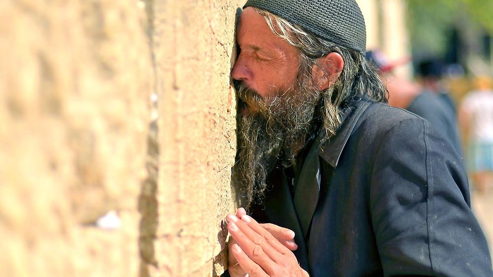 Illustration: Elderly Man Prays At The Kotel In Jerusalem by U.S. Air Force photo/Staff Sgt. Mikhail Berlin [Public Domain]