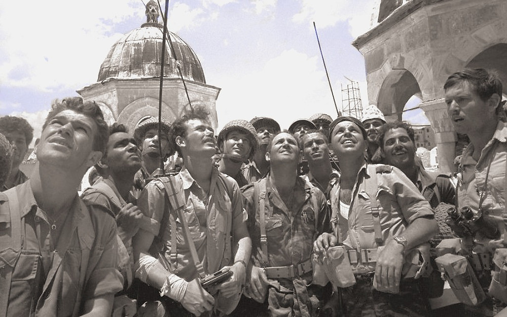 A group of paratroopers marvels at the Temple Mount on June 7, 1967, during the Six Day War (Credit: Micha Bar-Am, Ministry of Defense, IDF Archive)