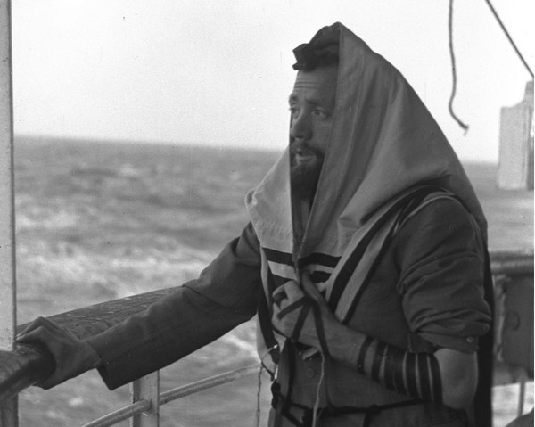 Illustration: Laying tefillin on S.S. Galila to Haifa in 1949 (Image credit: Government Press Office of Israel)