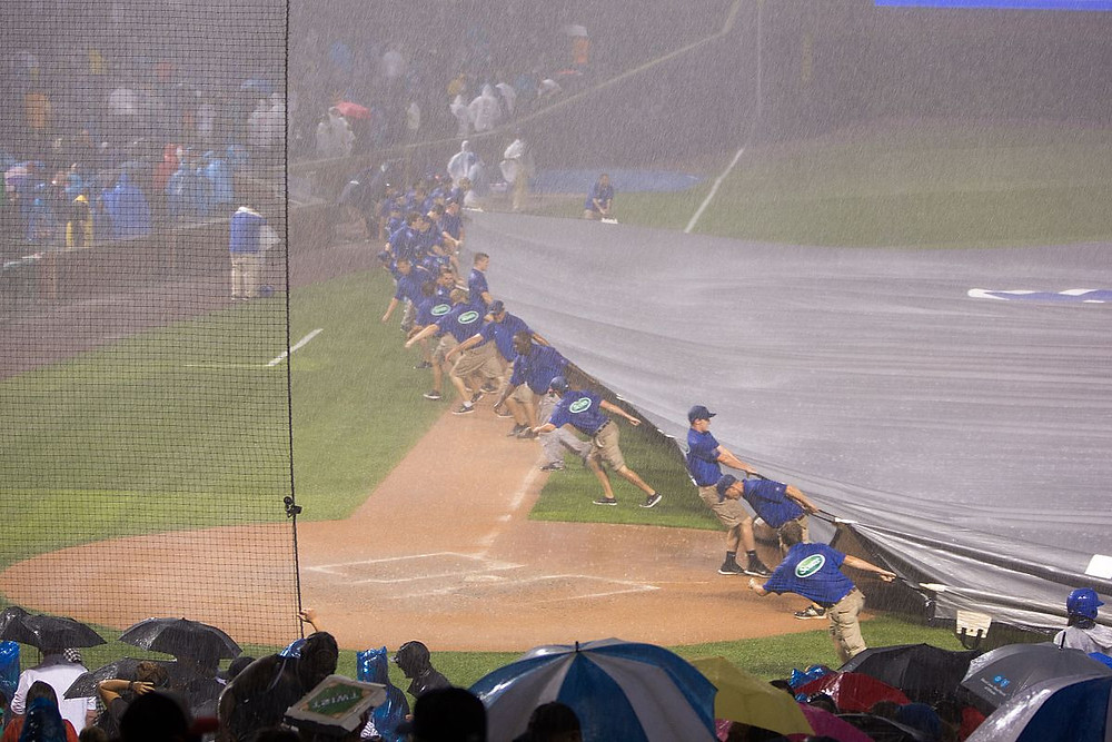 Illustration: Rain Delay at Baseball Game by Victor Grigas - Own work, [CC BY-SA 4.0], via Wikimedia