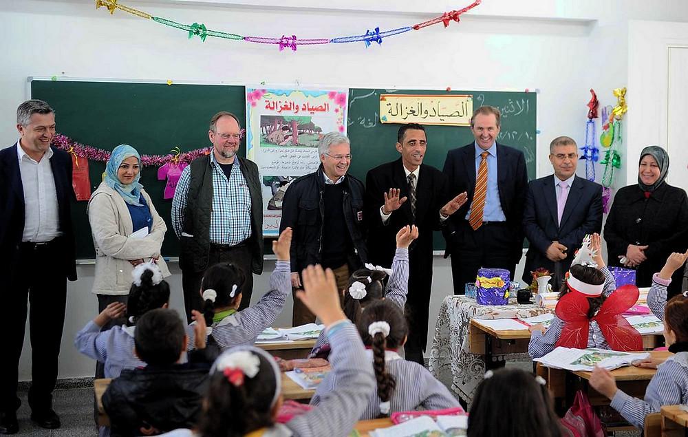 UNRWA officials with schoolchildren in Gaza, by UNRWA/Shareef Sarhan, licensed under CC BY-SA 2.0