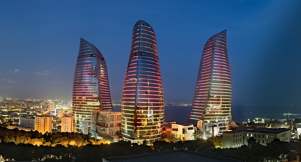 Illustration: Flame Towers in Baku (Photo by Investigation11111 - Own work, [CC BY-SA 4.0] via Wikimedia)