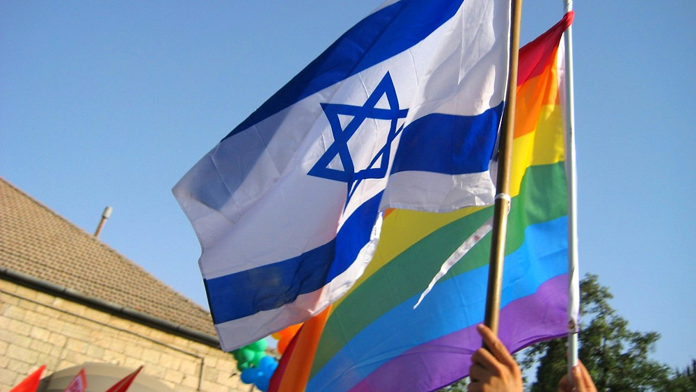 Illustration: Flags at Jerusalem Pride Parade by Andrew Ratto [CC BY 2.0] via Flickr