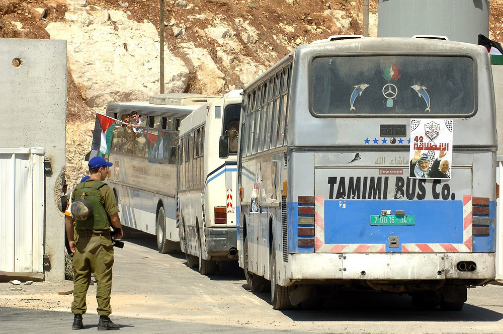 Arabs Passing Through Betunia Checkpoint (Image credit: Amos ben Gershom/Government Press Office of Israel)