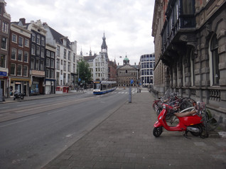 Red scooter and Tram in Amsterdam