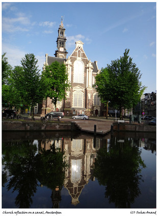 Reflection of a church in Amsterdam canal