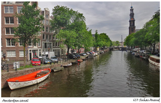 Boats lining edges of canal in Amsterdam