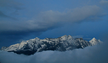 snow capped mountains amidst clouds.jpg
