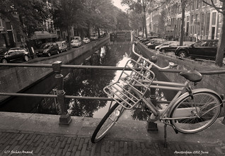 Bicycle over bridge in Amsterdam