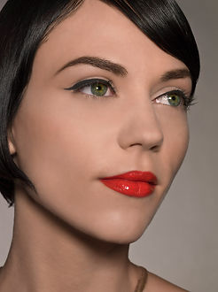 Winged liner with bright red lips.