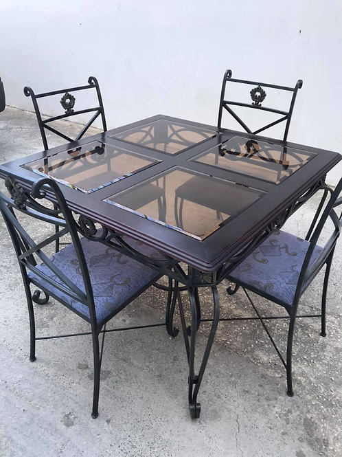 Dark wood table with black wrought iron legs and glass inlays