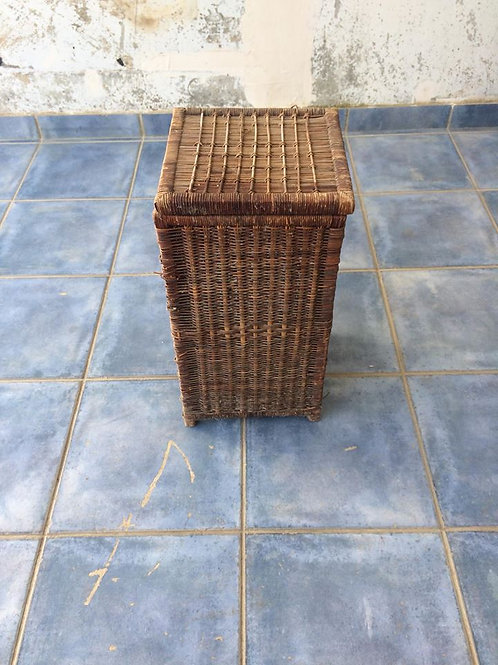 Brown wicker laundry basket