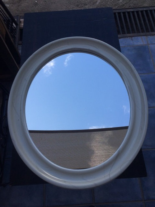 Oval, marble effect mirror