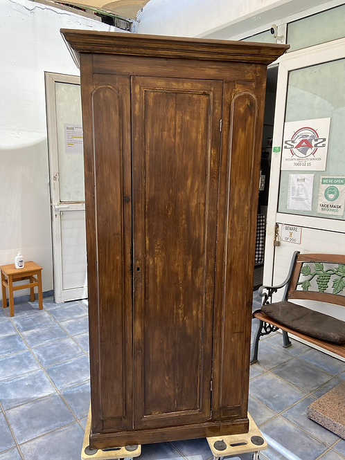 Vintage wooden wardrobe with shelving and hanging space