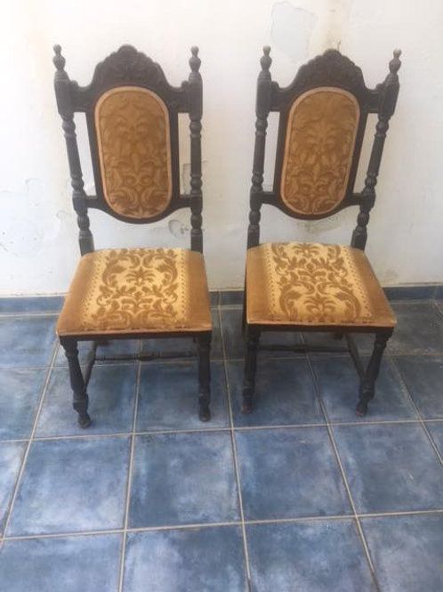 Two carved throne chairs