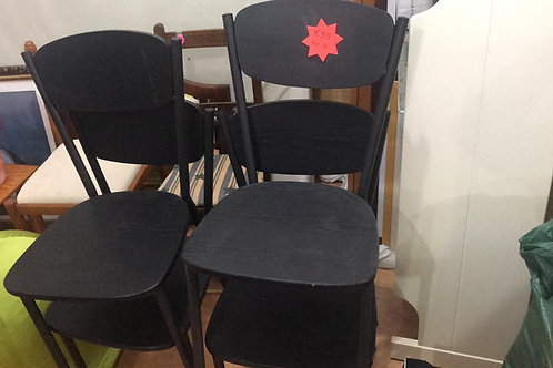 Four black dining room chairs