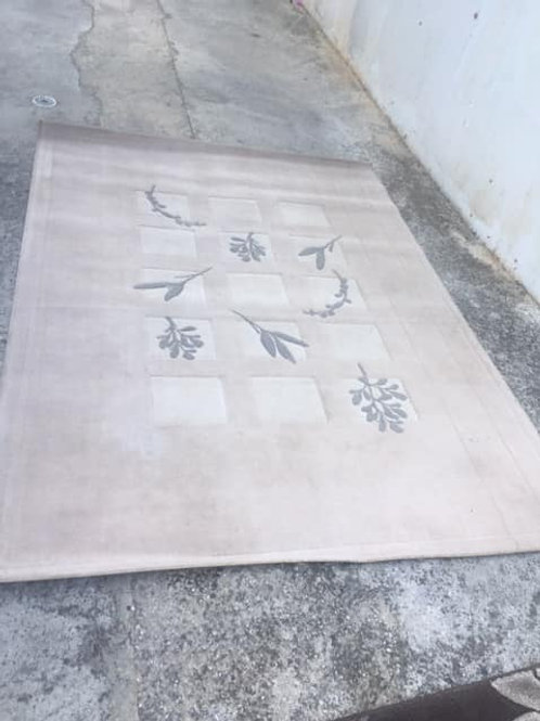 Cream patterned rug
