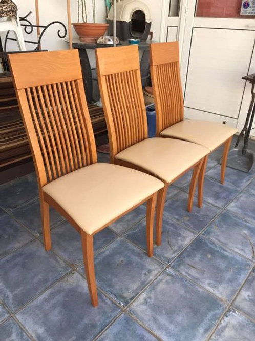 3 light wood dining chairs with cream faux leather padded seat