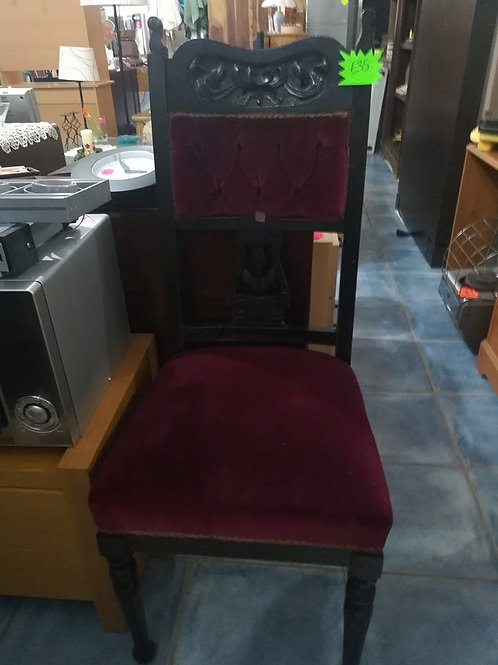 Beautiful carved chair with burgundy velvet tapestry
