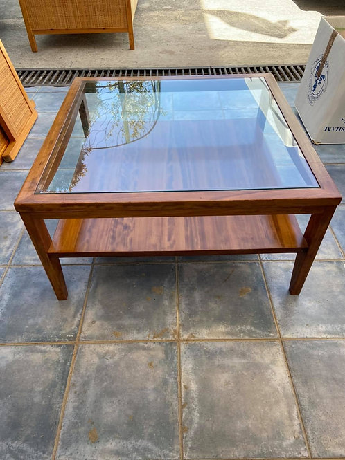 Light coloured veneer coffee table with glass top insert and shelf