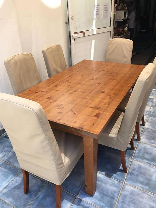 Large pine dining table and six cream dining chairs