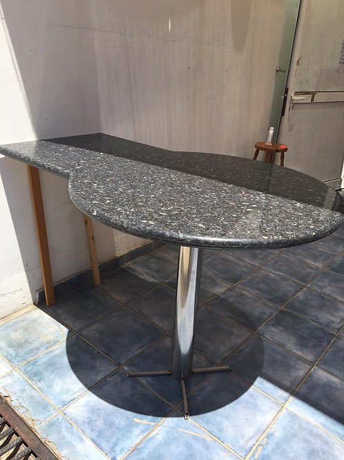 Solid granite breakfast bar with stainless steel base