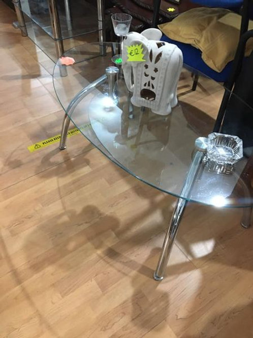 Oval and chrome coffee table