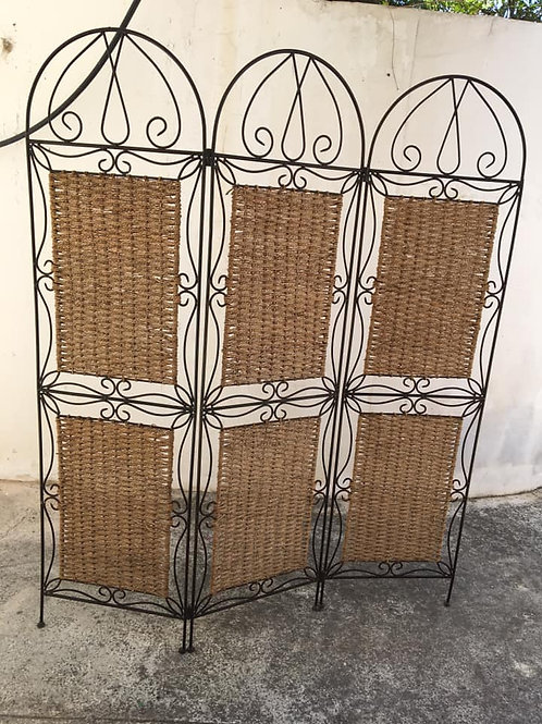 wrought iron and basket weave room divider