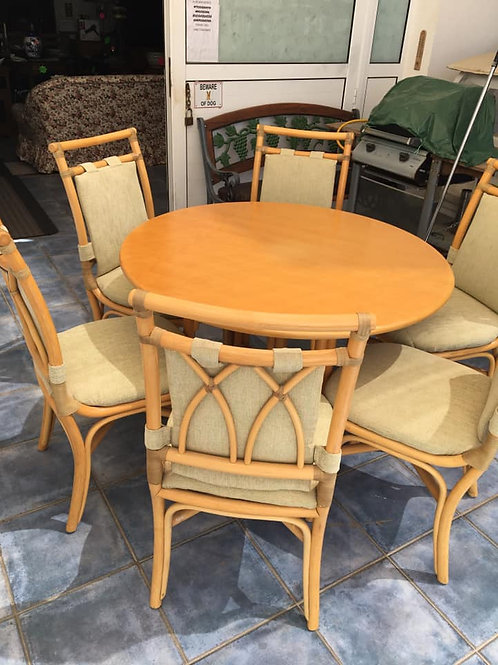 Round cane and pine dining table and six chairs