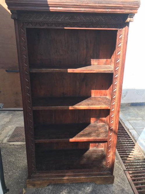 Indian wood bookcase with carved detail