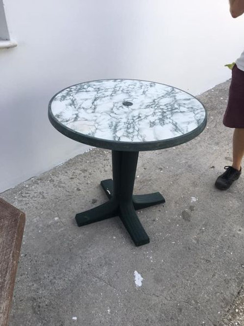 Green plastic marble effect round table