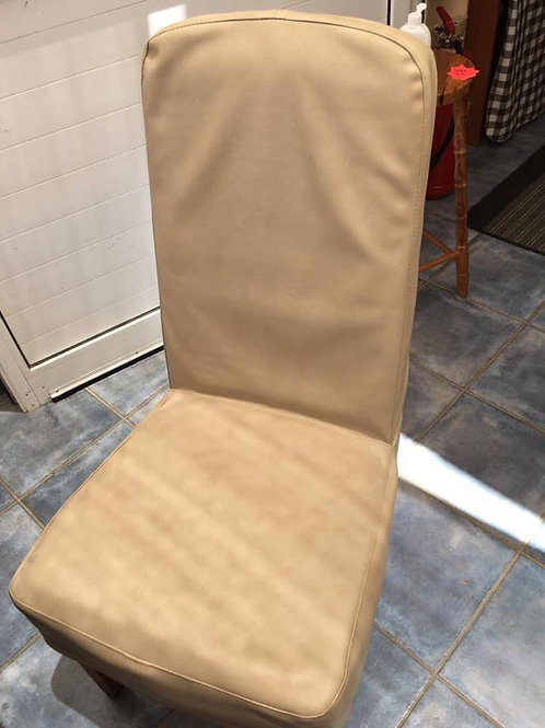Two cream leatherette dining chairs