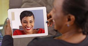 An older black woman talking to her daug
