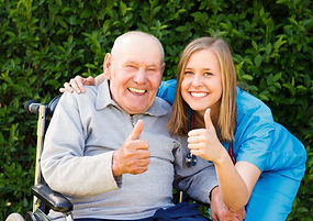 Happy smiling patient showing thumbs up