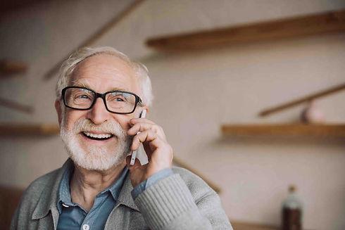 smiling_elderly_man_on_phone.jpg