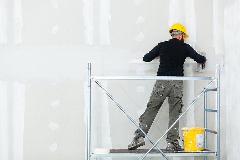 worker-plastering-gypsum-board-wall.jpg