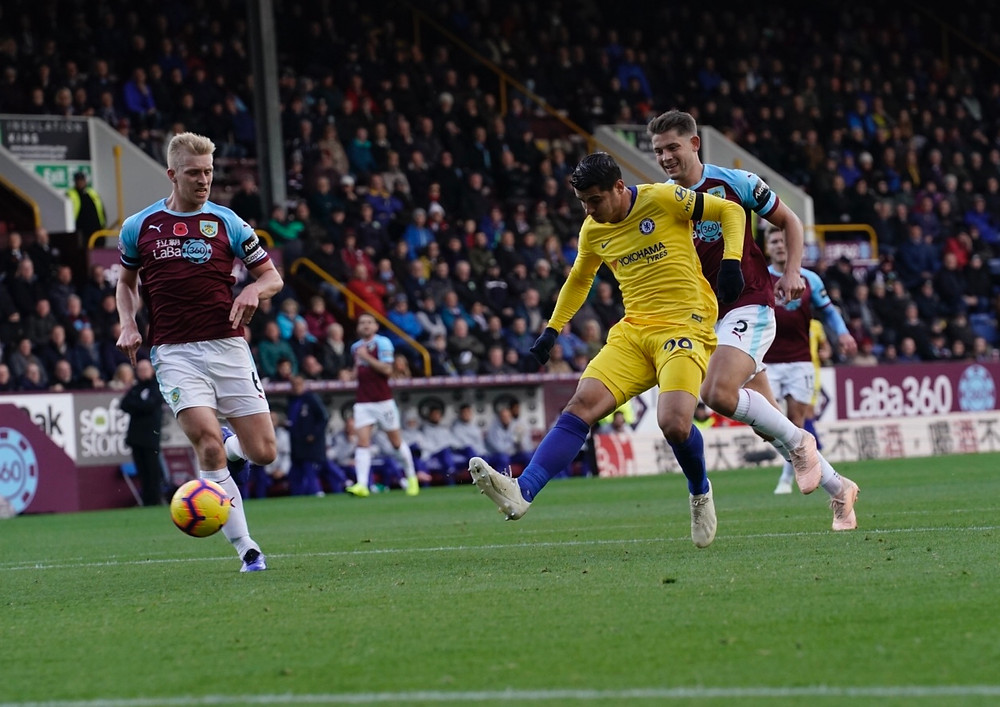 Alvaro Morata opens the scoring in a 3-0 at Turf Moor against Burnley. Photo by Sean Gosling