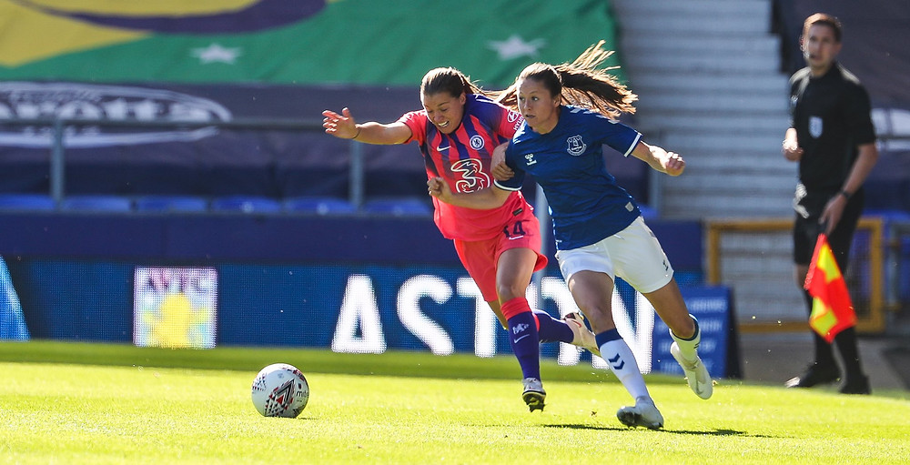 Fran Kirby tussles  with an Everton player