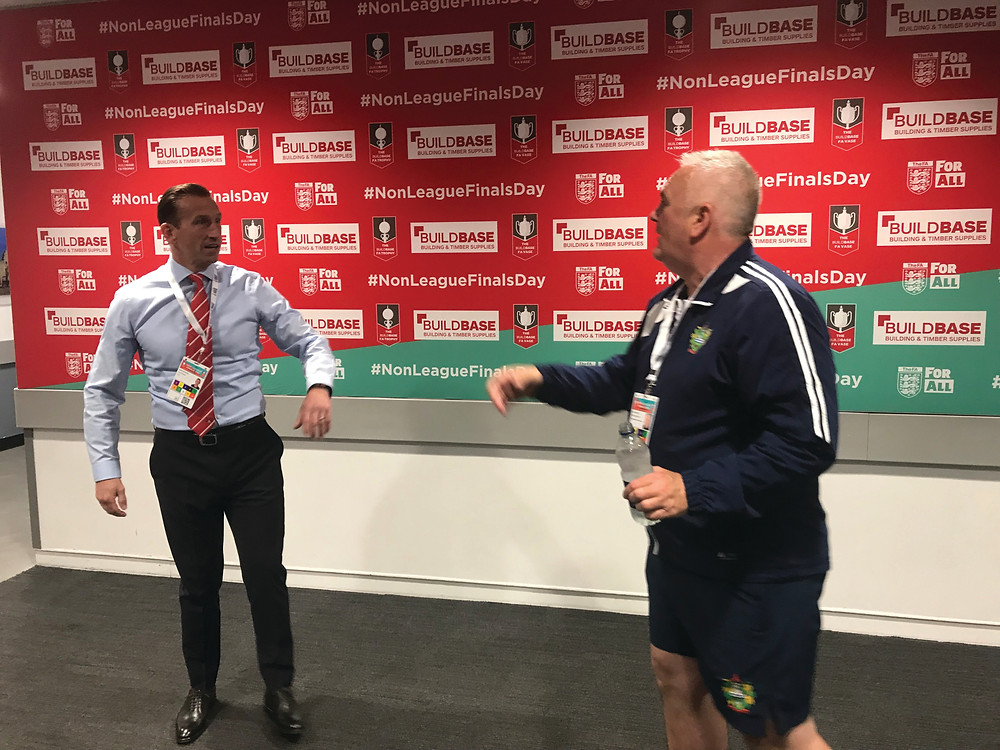 Justin Edinburgh meets Chertsey Town manager Dave Anderson in the Wembley mixed zone just before Orient's play-off match