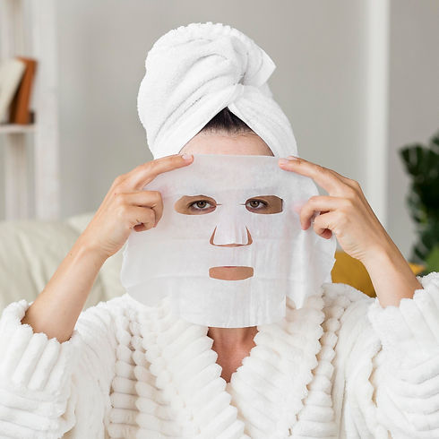 front-view-woman-applying-facial-mask.jp
