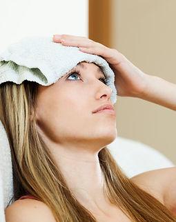 girl-with-wet-towel-forehead-min.jpg